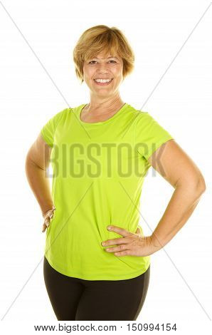 Middle Age Woman a White  background wearing exercise clothes.  She has her hands on her hips and is smiling with confidence.