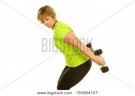 Middle Age Woman Exercising with Weights on a White Background.  She is doing tricep kickbacks.
