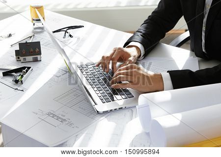 Hands Of Ceo Of Construction Company In Black Suit Typing Message Via E-mail To Partners On Laptop W