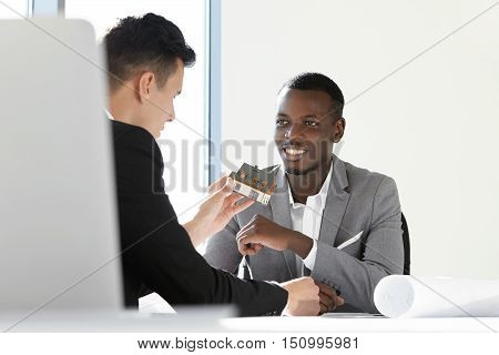 Two Executives Of Construction Company Discussing New Housing Project. Caucasian Chief Engineer Hold