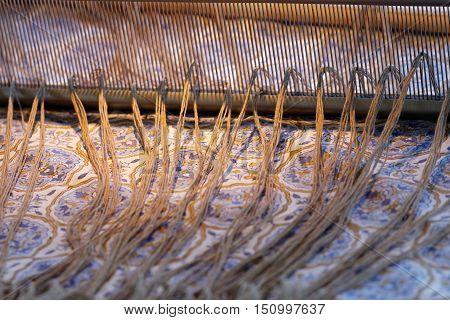 Preparing a loom before starting to make carpets. Warm light