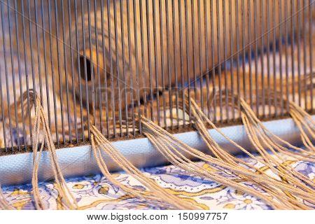 Preparing a loom before starting to make carpets. Warm light.