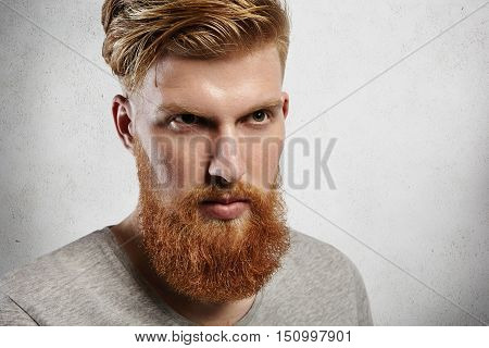 Harsh Caucasian Man With Perfect Light Skin Looking Ahead Like A Brave Hero. His Fringe Is Carefully
