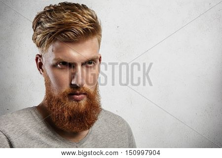Portrait Of Young European Hipster With Fair Skin And Trendy Ginger Beard. Fashionable Undercut Hair