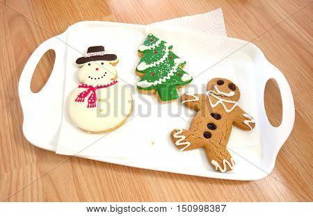 Christmas tree Snow man Ginger bread cookie on white tray