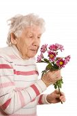 picture of elderly woman  - The old woman with a bunch of flowers - JPG