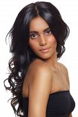 stock photo of black curly hair  - beautiful woman with long black curly hair tanned skin and natural make - JPG