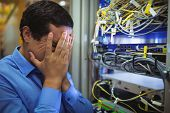 Technician getting stressed over server maintenance in server room poster