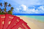 International passports of Russia against a tropical beach - the international passport your admissi