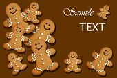 Smiling gingerbread men on brown background with copy space.