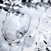 Three glass goblets on white table