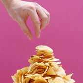 stock photo of potato chips  - Eating potato chips - JPG