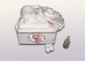 stock photo of ecclesiastical clothing  - beautiful chest with gifts baby