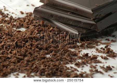 Grated dark chocolate and few chocolate pieces.