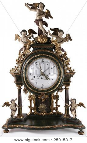 An antique clock with figurines of cupids