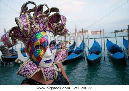 Carnival  in Venice, Italy. Gondolas and San Giorgio Maggiore church in background