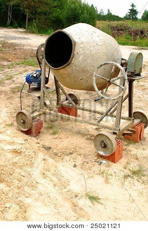 Old concrete mixer on a building site