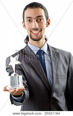 Businessman receiving star award on white
