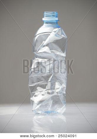 Empty shrunken plastic bottle