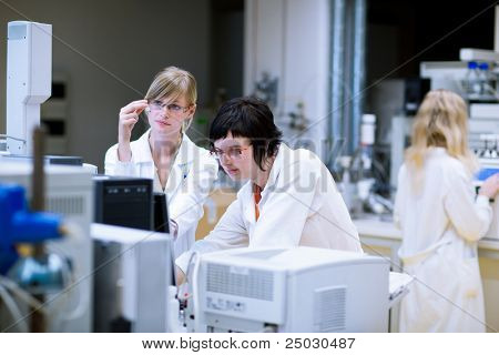 female researchers/chemistry students doing research in a chemistry lab