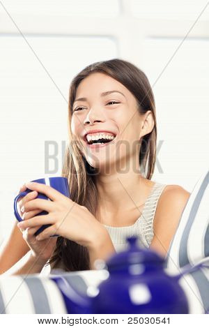Woman Laughing Drinking Tea
