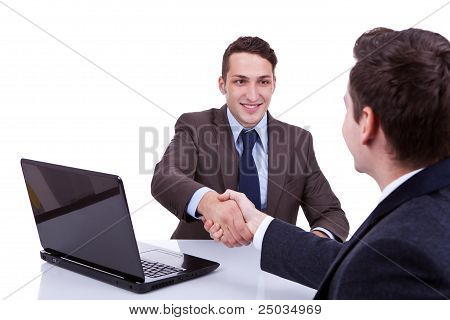 Business Men Reaching To An Agreement
