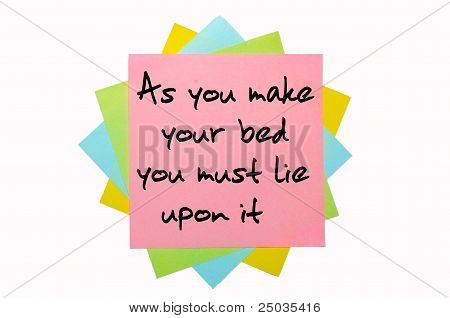 "Proverb ""as You Make Your Bed You Must Lie Upon It"" Written On Bunch Of Sticky Notes"