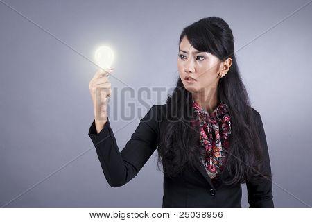 Beautoful Businesswoman With Light Bulb
