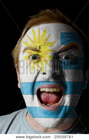 Face Of Crazy Angry Man Painted In Colors Of Uruguay Flag