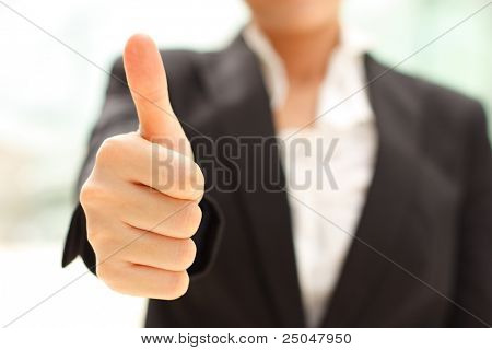Business woman shows thumb up