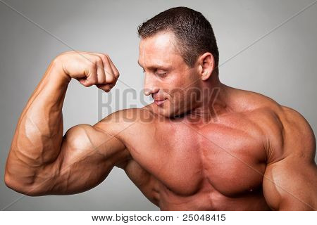Muscular Man Flexing His Biceps