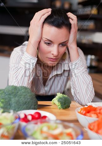 Sad Woman In Kitchen