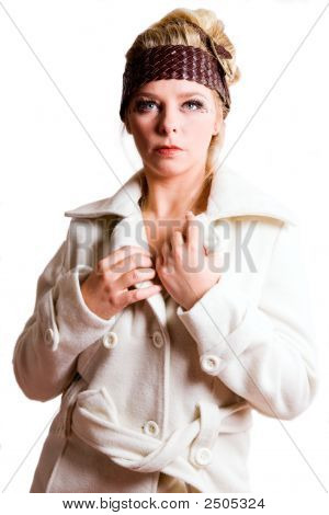 Fashion Portrait Of A Blond Girl In A White Coat
