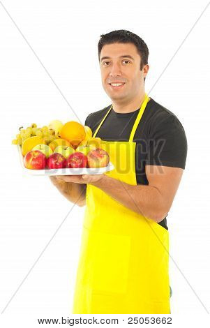 Greengrocer Holding Fruits