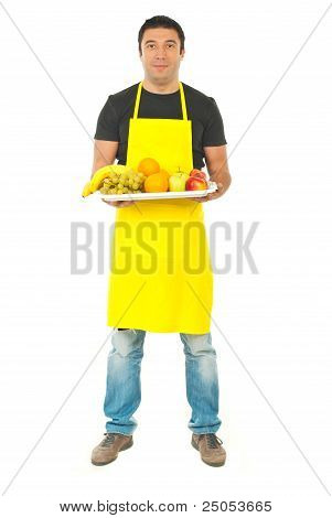 Full Length Of Greengrocer With Fruits