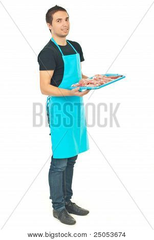 Full Length Of Butcher Holding Meat