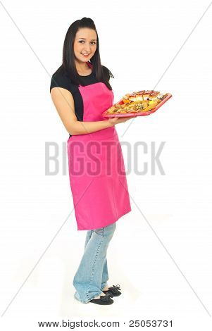 Full Length Of Confectioner With Cakes