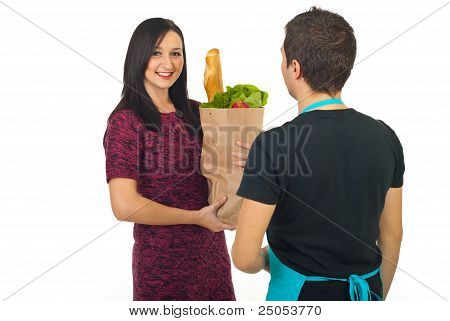 Happy Woman Purchasing Food At Grocery