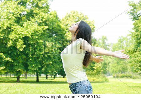 Young Woman Enjoying Beautiful Summer Day