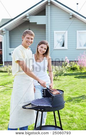 Young couple make the barbecue