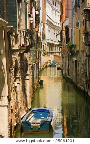 Canal View With Boat In Venice
