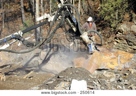 Hydraulic Drill Boring Into Rocks