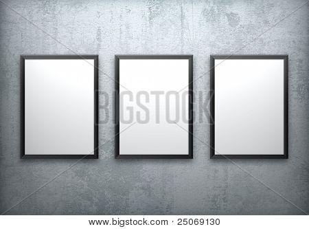 Three blank frames on concrete wall.