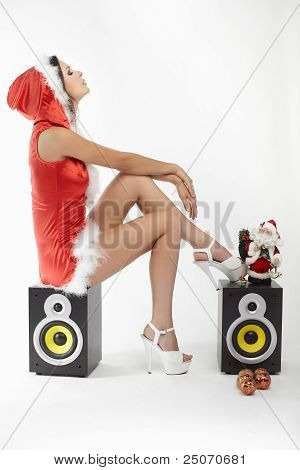 sexy brunette woman posing in Santa costume