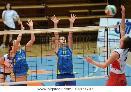 KAPOSVAR, HUNGARY - OCTOBER 21: Karmen Kovacs (blue 12) in action at a Hungarian NB I. League volleyball game Kaposvar (blue) vs Godollo (white), October 21, 2011 in Kaposvar, Hungary.