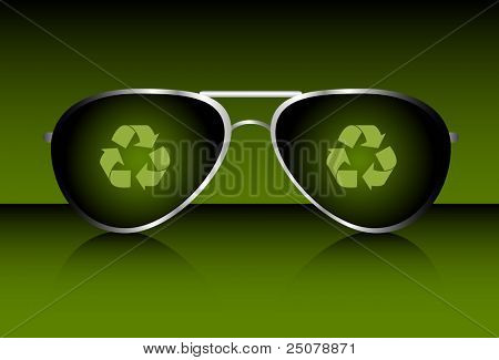 A pair of aviator sunglasses with recycling symbols. Environmentally friendly concept - Recycling is cool.
