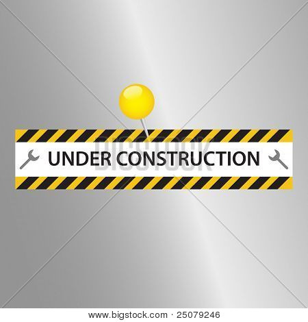 Under Construction sign pinned to a metallic surface.
