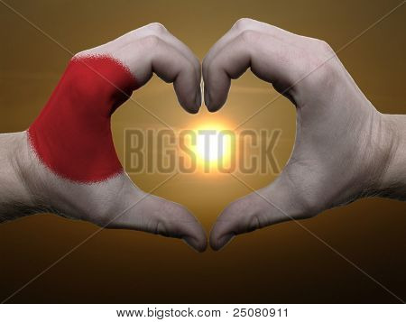 Heart And Love Gesture By Hands Colored In Japan Flag During Beautiful Sunrise
