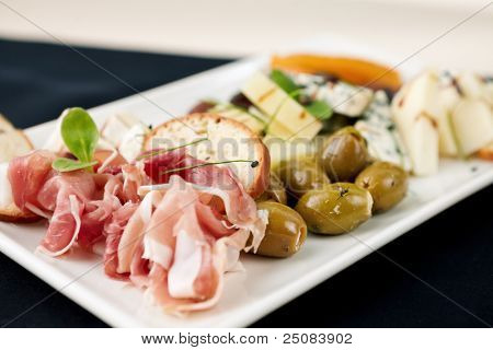 Snacks selection for wines (Parma ham, olives, cheese)