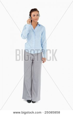 Businesswoman listening to caller with headset on against a white background
